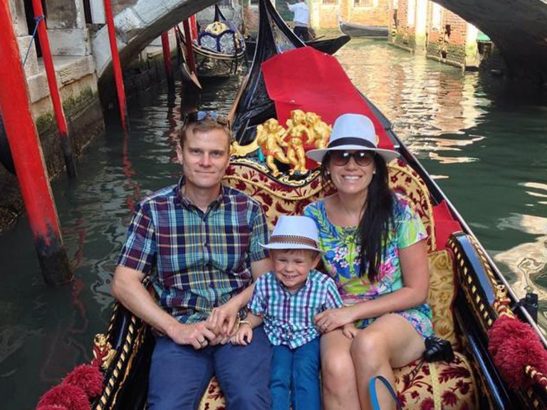 young family on a gondala in Venice