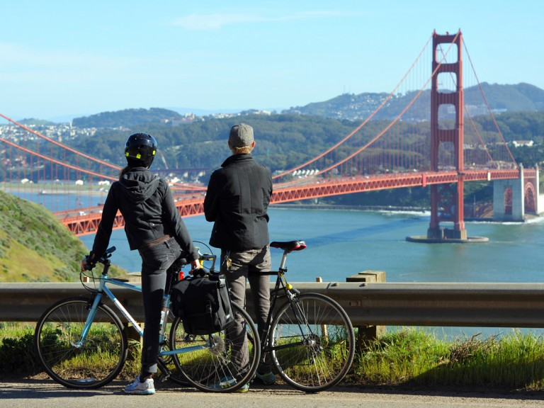 two cyclists viewing San Francisco bridge