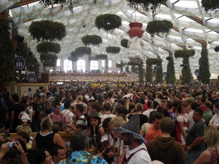 crowd indoors drinking beer