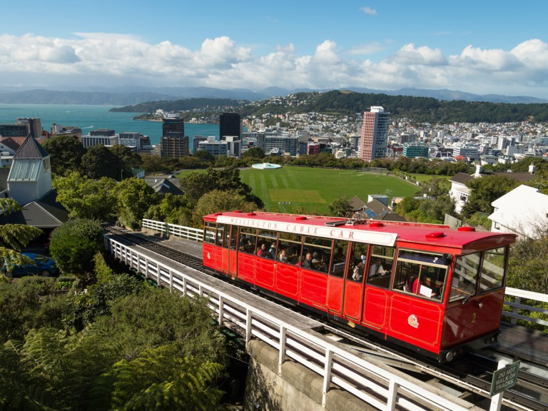 tourists viewing sights on cable car
