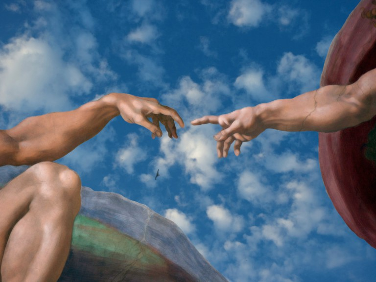 fingers touching painting on Sistine Chapel