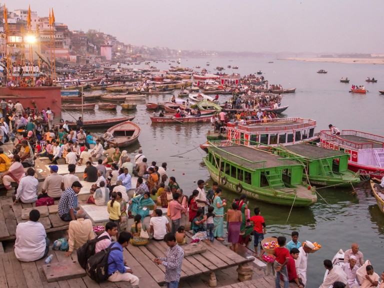 crowded water edge in India