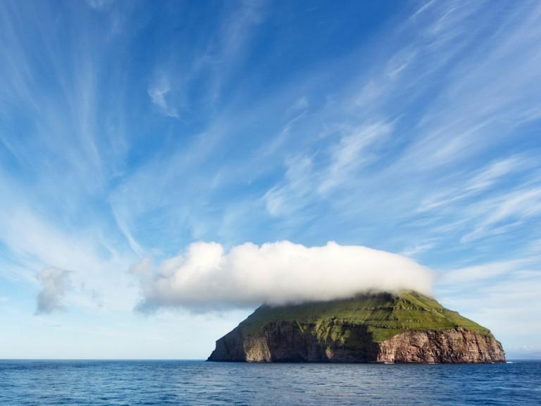 grassy Faroe Island in ocean